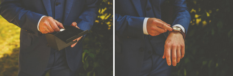 The groom opens a box with a watch inside it and places the watch onto his wrist