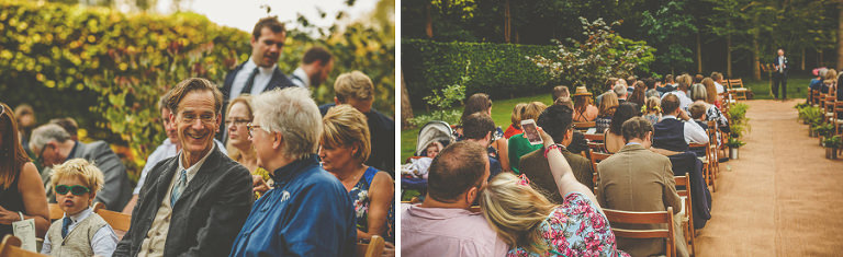 Wedding guests sit on chairs at the outdoor wedding ceremony