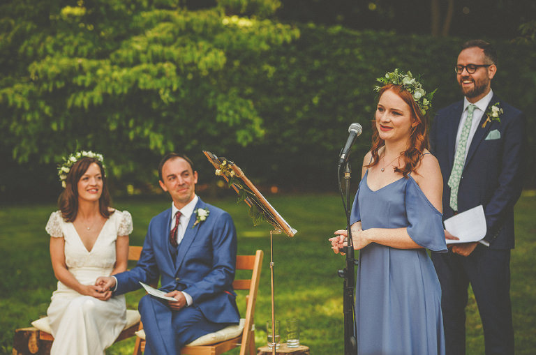The brides sister delivers a speech during the outdoor wedding ceremony