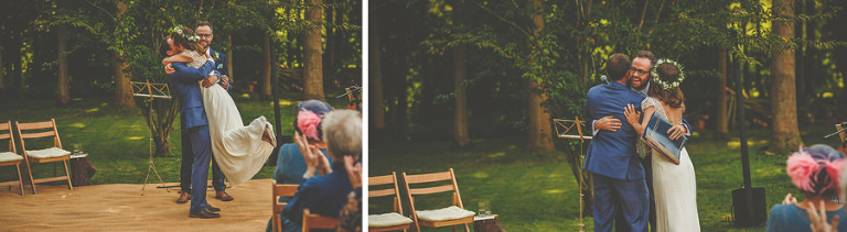 The bride and groom embrace each other at the end of the outdoor wedding ceremony