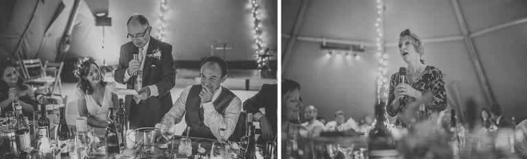 The grooms father stands up and delivers his speech in the marquee