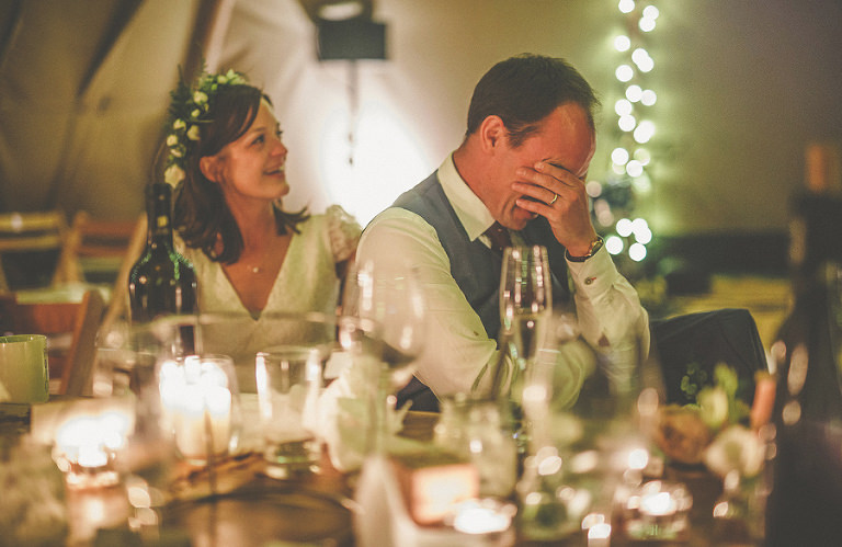 The groom puts his hands into his face