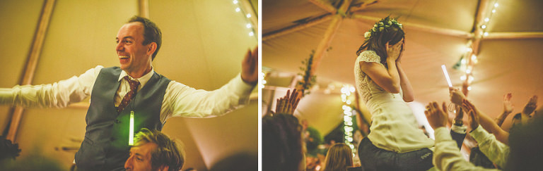 A man lifts the groom into the air on the dancefloor in the marquee