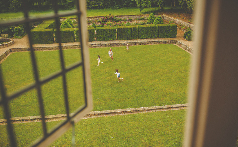 Children play on the front lawn at Voewood