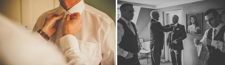 The best man straightens the grooms tie