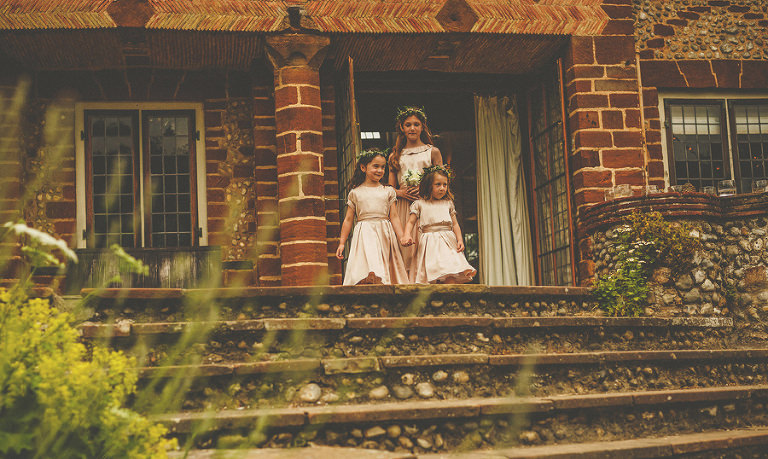 The flowergirls leave the house and start to walk down the stone steps