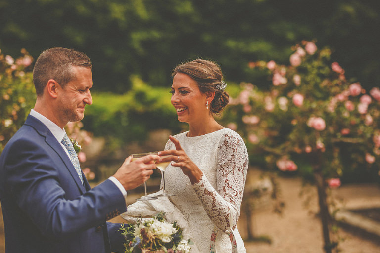 The bride and groom celebrate with a glass of champagne