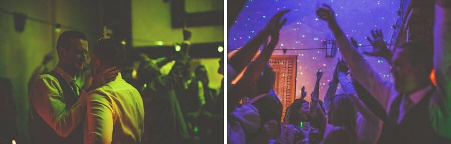 Wedding guests raise their arms in the air on the dancefloor
