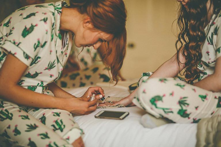 A bridesmaid puts on nail varnish