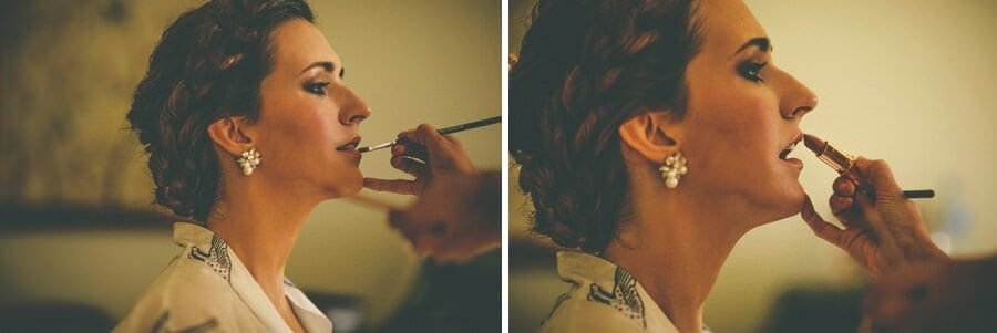 The make up artist applies lip stick onto the brides lips