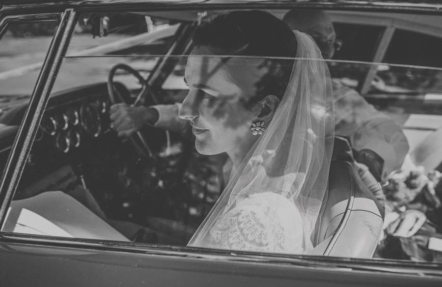 The bride arrives outside St. Benets Minster, Suffolk