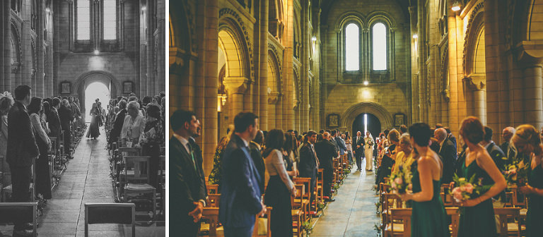 The bride and her father walk down the aisle of St. Benets Minster, Suffolk
