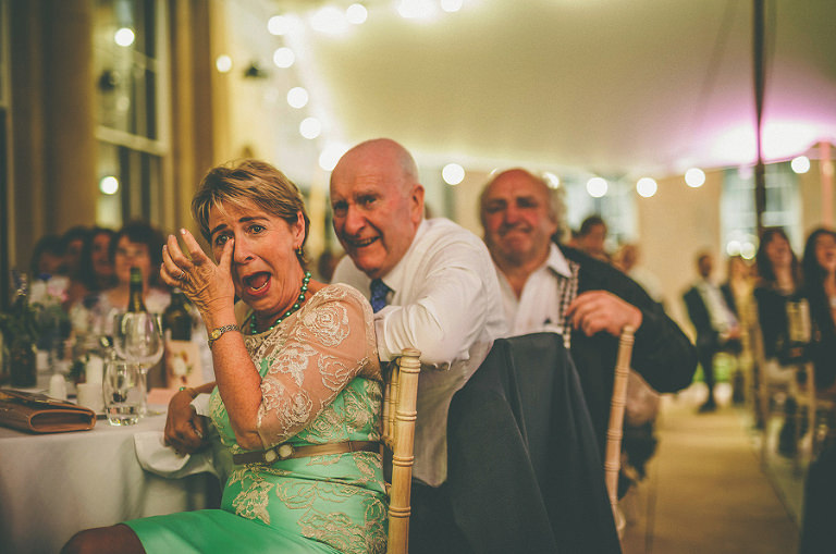 A wedding guest cries with laughter at the best mans speech