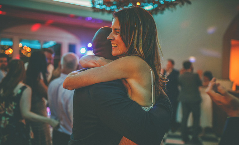 Friends of the bride and groom dancing on the dancefloor