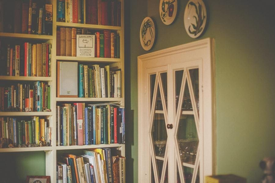 Books on a shelf in the corner of a room