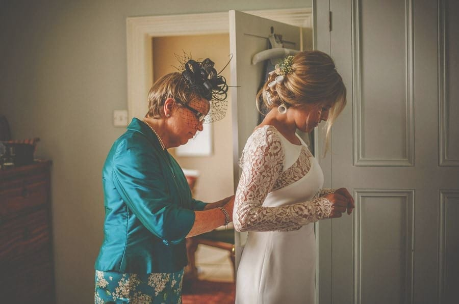 The bride puts on her dress