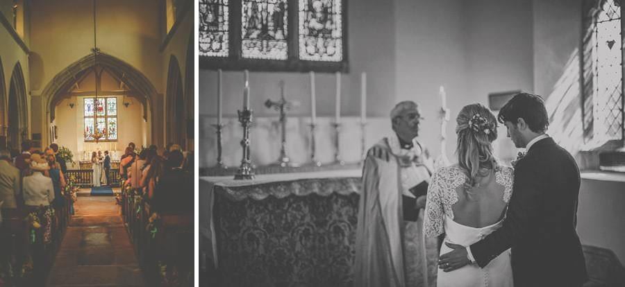 The bride and groom at the alter of the church of St. Mary the virgin Batcombe