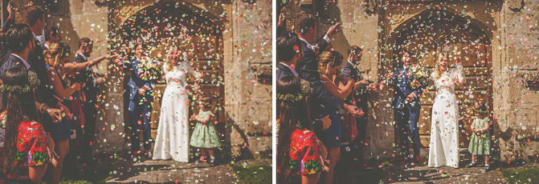 Confetti is being thrown at the bride and groom at the church of St. Mary the virgin Batcombe