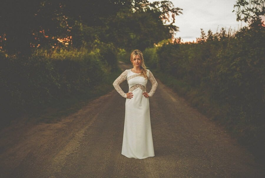 The bride standing in the middle of the road at Penny Square barn