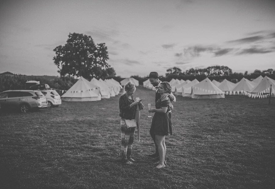 Wedding guests walking back from the tipis