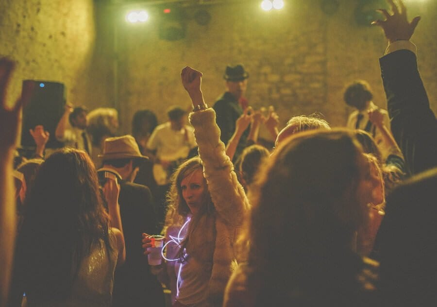 Wedding guests dance in the barn