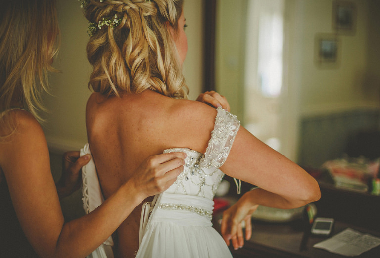 The bride puts on her wedding dress