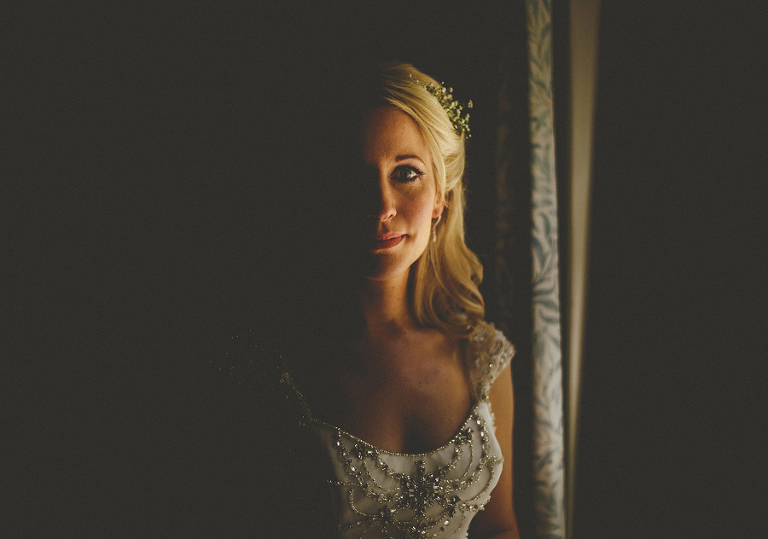 The bride stood next to a window at Cole Hayes park