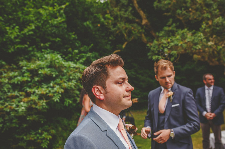 The groom cries as he sees the bride for the first time