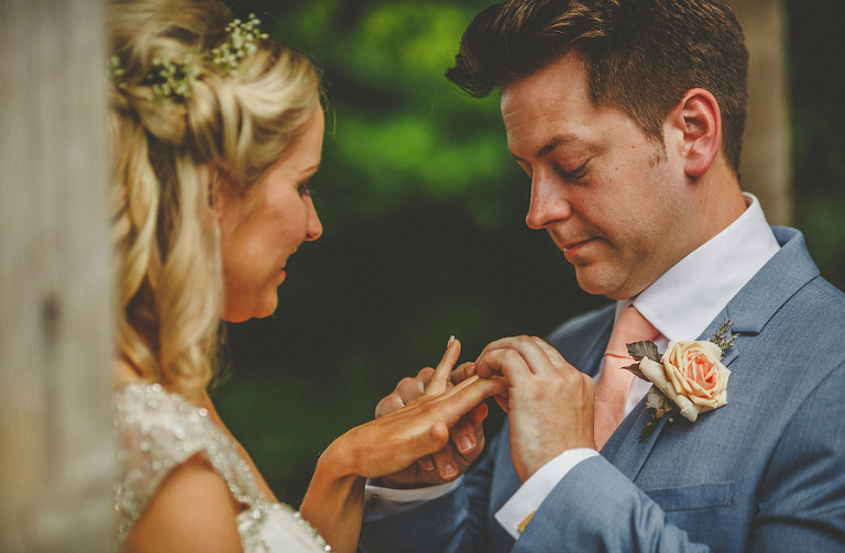 The bride and groom exchange wedding rings during the ceremony