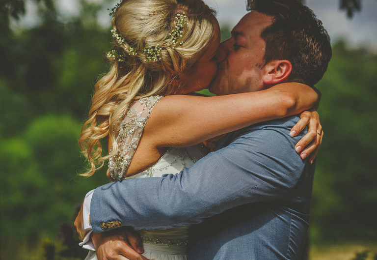 The bride and groom kiss for the first time as husband and wife