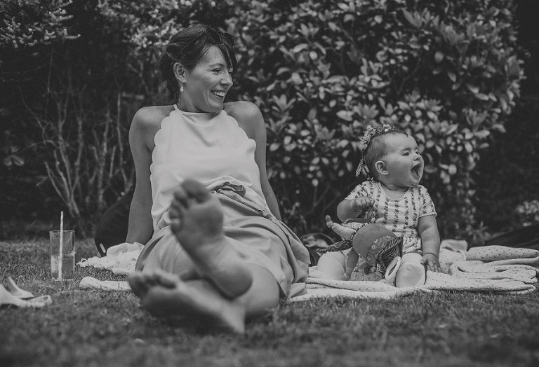 A baby laughs on the back lawn at Cole Hayes park