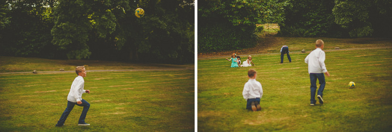 Boys playing football on the front lawn of the house