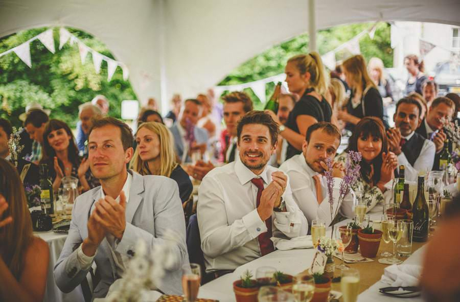 The wedding guests applaud the brides speech