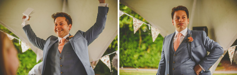The groom raises his arms in the air and smiles