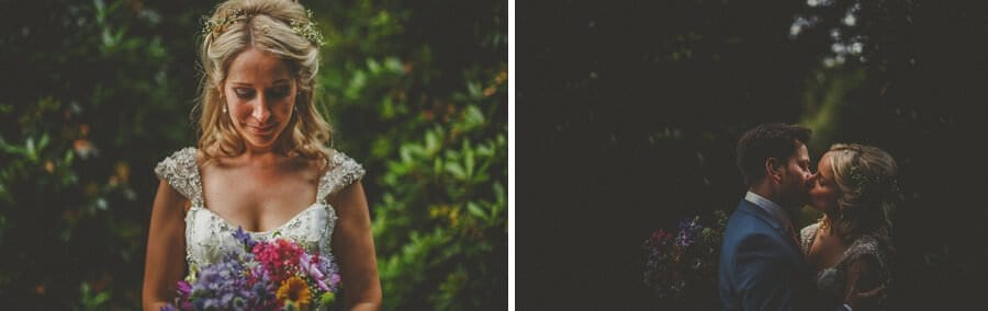 The bride looks at her bouquet and kisses her husband