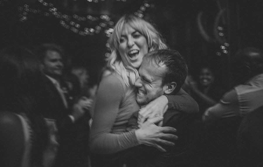 A man lifts up a lady on the dancefloor