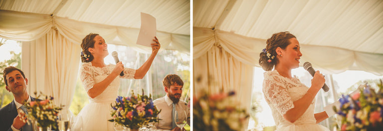 The bride stood at the top table and delivers her speech