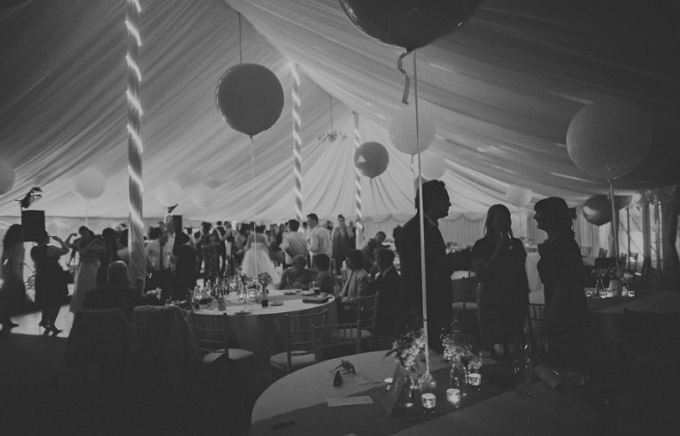 A view of the marquee with the wedding party dancing in the background