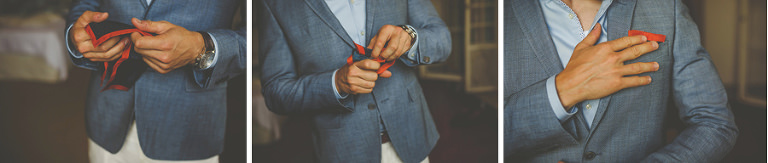 The groom adjusts his handkerchief and places it into his chest pocket