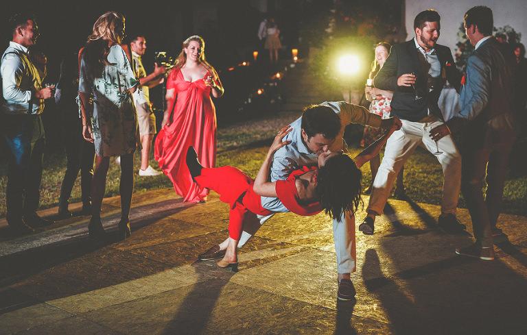 Two wedding guests salsa dancing