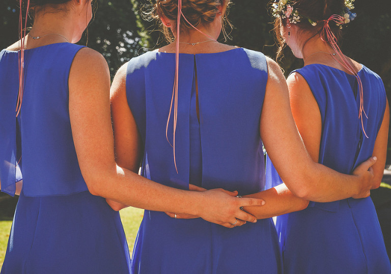 The bridesmaids get together for a photograph
