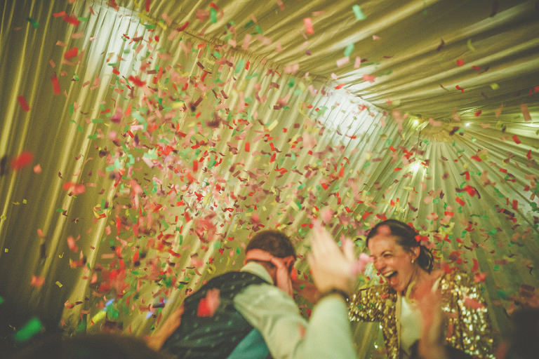 The bride and groom get showered with confetti on the dancefloor