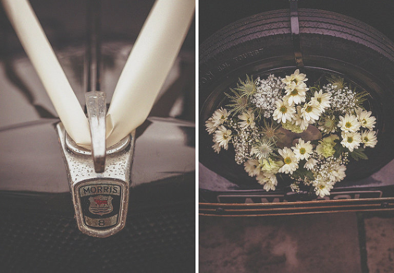 Flowers and ribbon on the front of the vintage car