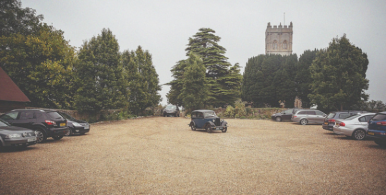 The vintage car arrives at Almonry Barn