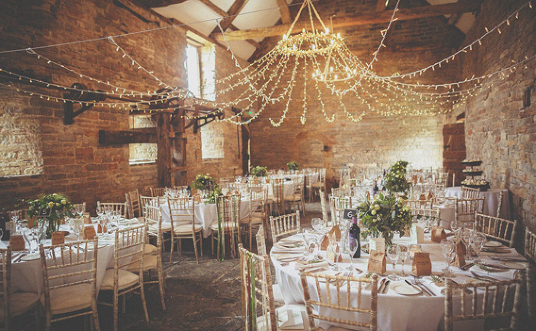 Tables, chairs and decorations at Almonry Barn
