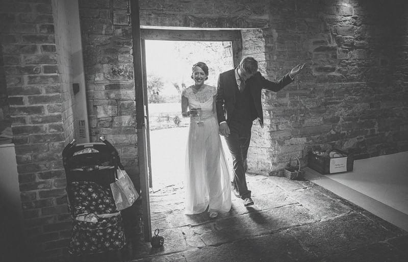 The bride and groom enter the barn