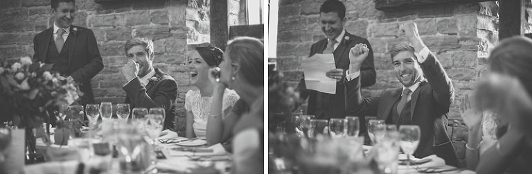 The groom raises his hands in the air during the best mans speech