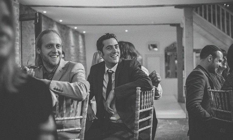 A wedding guest laughs during one of the wedding speeches