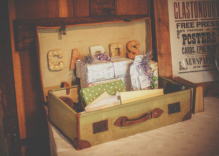 A suitcase with cards and presents on a table in the barn