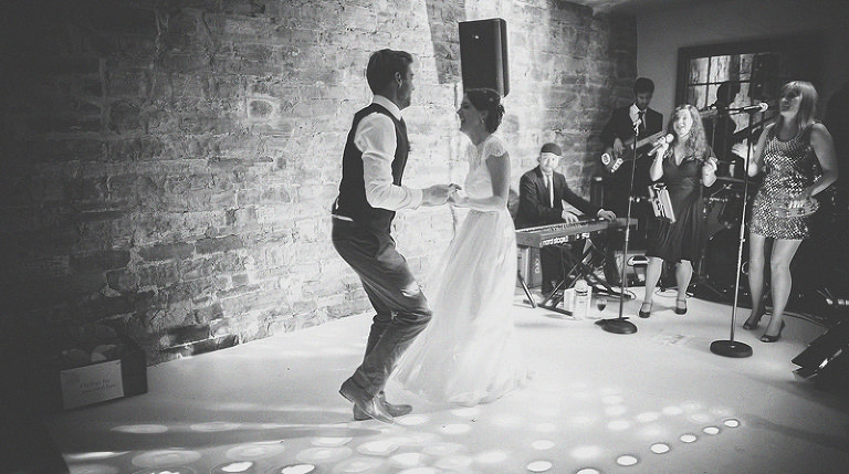 The bride and grooms first dance at Almonry Barn